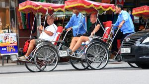 Tourists on Cyclo in Hanoi, Vietnam, included in tours offered by Asia Vacation Group