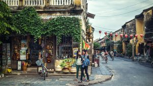 People on street in Hoi An Old town Vietnam, included tours offered by Asia Vacation Group