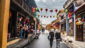 People walking on Hoi An Old Town street, Vietnam