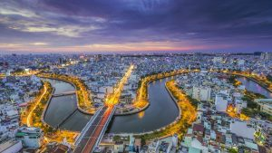 Aerial view of Saigon River at night in VIetnam,, offered in a tour with Asia Vacation Group